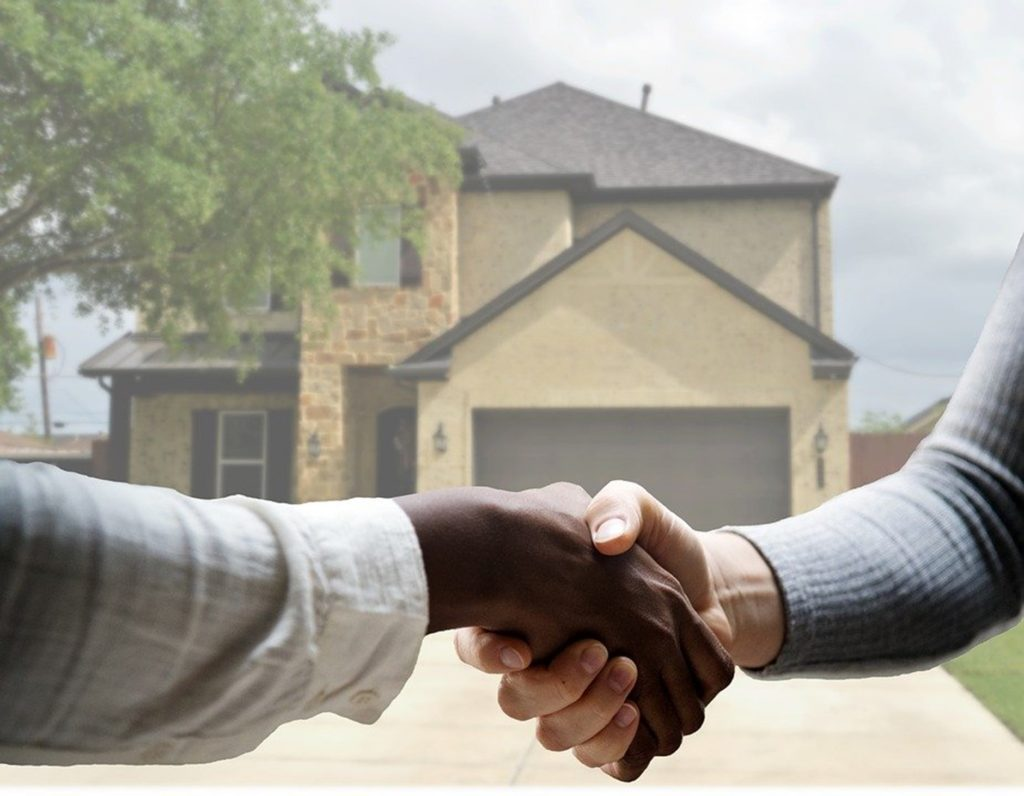 Shaking hands on a finalized real estate deal.